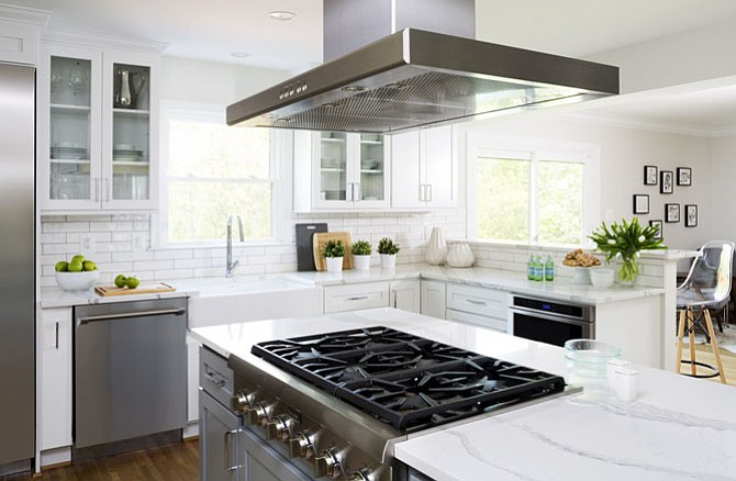 "This kitchen by Case Design/Remodeling, Inc. includes a cooktop with a 36"" island range hood."