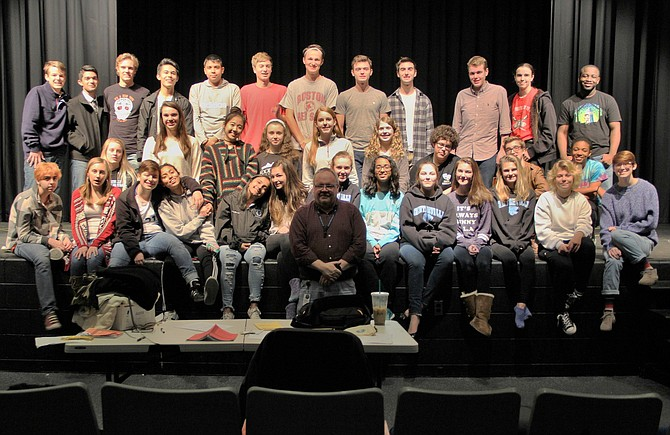 "The cast of Centreville High's ""Dracula"" poses with Director Mike Hudson (front, center)."