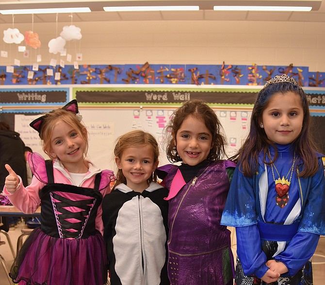 Zoe Adelson, Susannah Katsans, Roxana Yazdankhah, and Sophia Derechin in Julie McDonald's Kindergarten class at Carderock Springs Elementary School on Tuesday, Oct. 31.