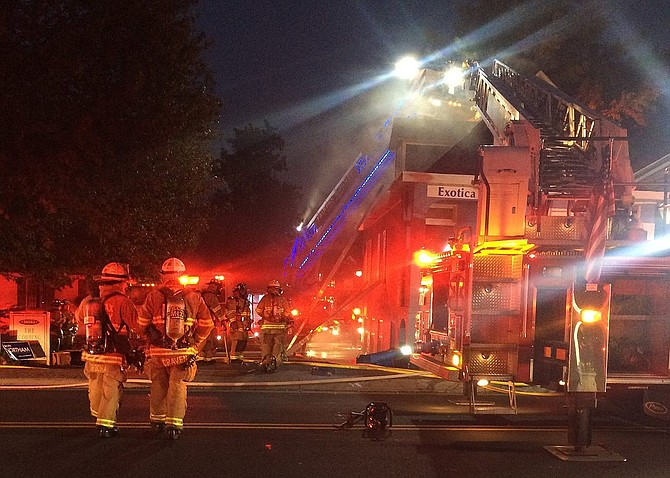 Firefighters at the scene of the Nov. 2 blaze at Exotica Florist in Old Town Fairfax.