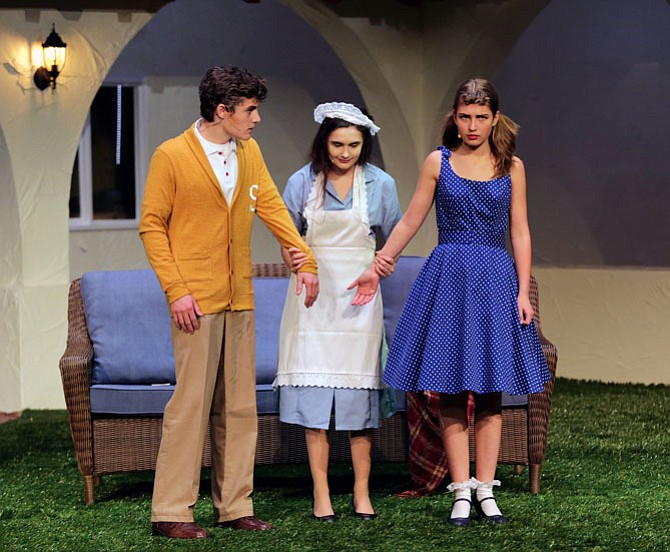 "From left: Campbell Weiss, Nikki Bires, and Bette Vadja in the St. Stephen's & St. Agnes production of ""Tartuffe."""