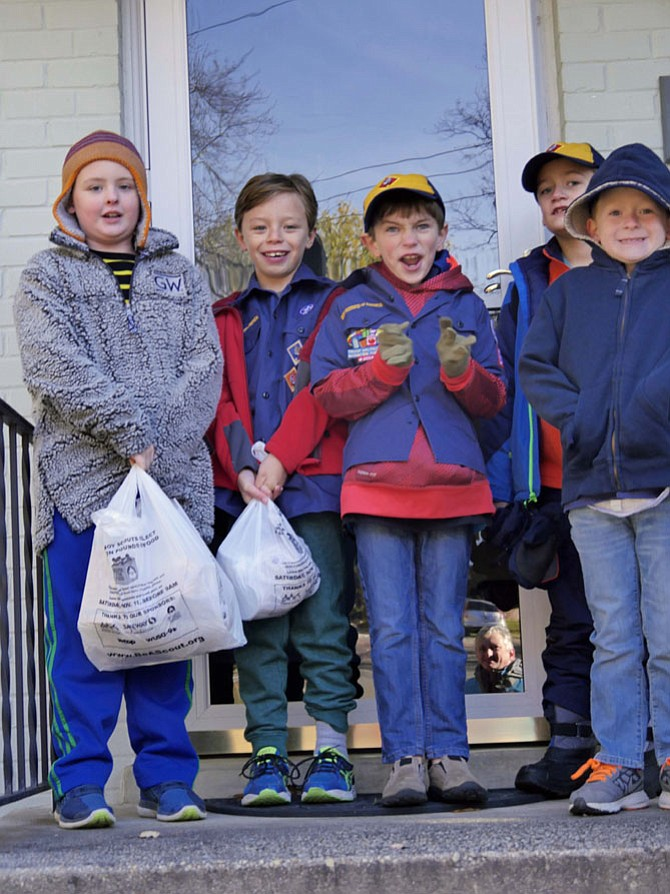 "Cub Scout Troop 641 volunteers, in 23-degree temperature, collect food as part of the annual national Scouting for Food drive. This is their second year of participating as part of the Scout Slogan ""to do a good deed daily."" Their collection area covers Albermarle, Chesterbrook and Glebe Road."