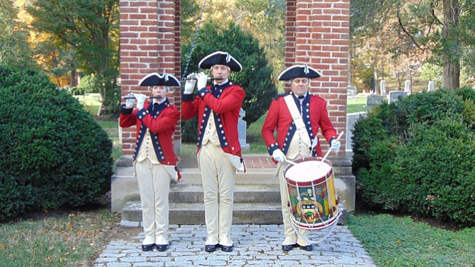 The U.S. Army Old Guard Fife and Drum Corps performs at the ceremony at Historic Pohick Episcopal Church.