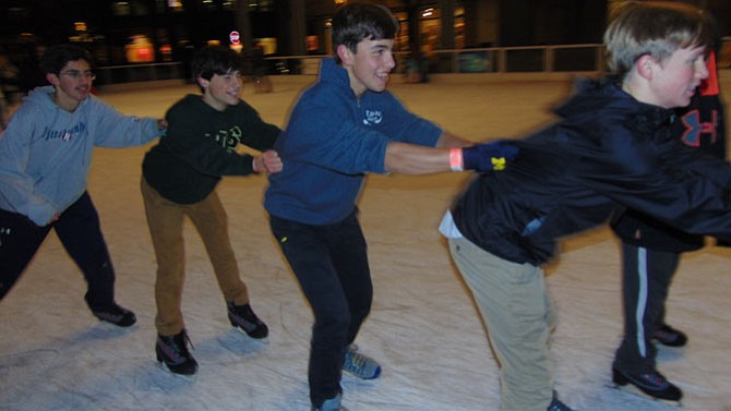 Forming a train at the Reston Town Center Ice Skating Pavilion are McKean McConnell, 15, of Great Falls; Marc James-Finel, 15, of McLean; Thomas Ryan, 15, of Great Falls; and Aidan Kenny, 15, of Great Falls.