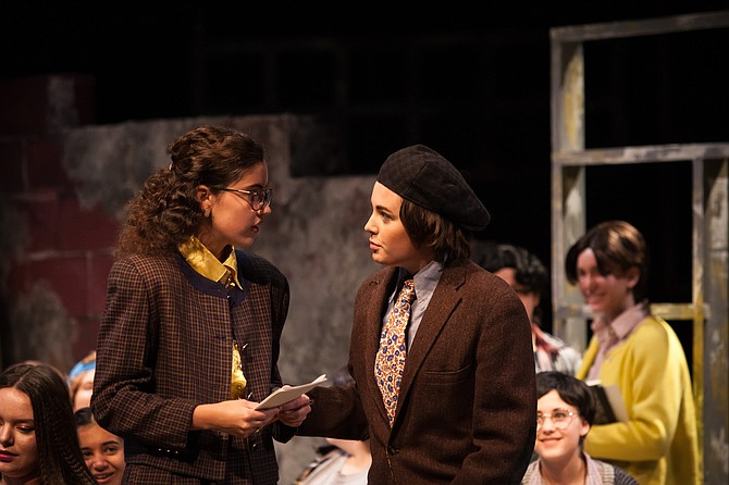 "From left: Alex Raposo as Sylvia Barrett, Mallie Moore as Paul Barringer; background from left: Caroline Potter, Neha Sinha, Anna Blackmon, Alika Mattheisen in the Madeira School production of ""Up the Down Staircase."""