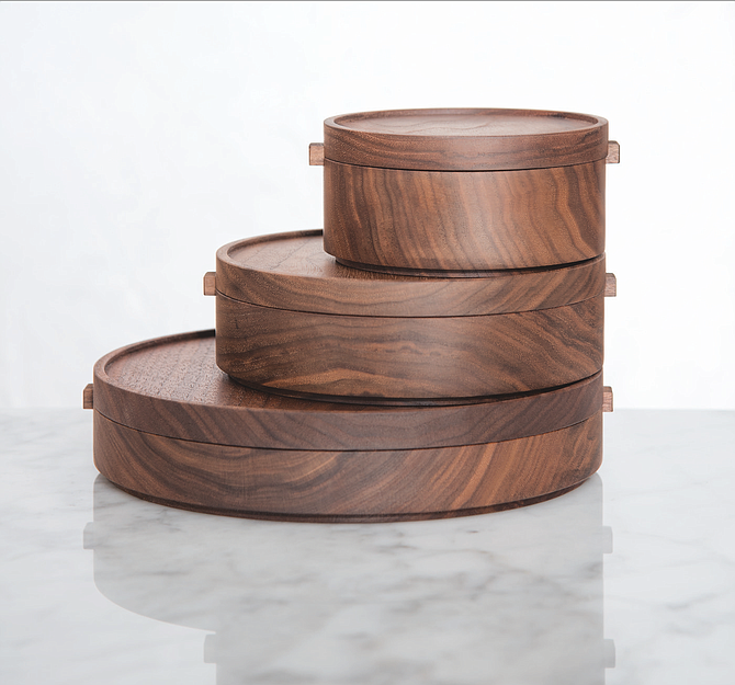 Stackable, food-safe wooden bowls, such as these by Thos. Moser, Handmade American Furniture, are sustainable and reusable.