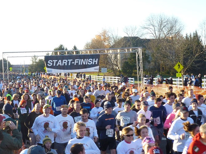 Thousands of people run and walk in the annual Virginia Run Turkey Trot.