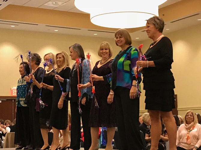 From left: runway models Elma Mankin, Barbara Torrey, Wanda Mitchell, Peggy Lanier, Joanne Emswiler, Kathy Herbert, Gabriele O'Bryan, and Linda Crawford take a bow at the end of the Herndon Woman's Club Fashion Show 2017. Proceeds from the show benefitted Luke's Wings.