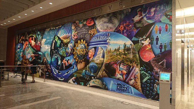 The 52-foot wide and 11-foot tall History Mural is the focal point of the new National Science Foundation Headquarters building in Alexandria. It provides a visual history of the NSF and depicts seven decades of scientific discovery and innovation.