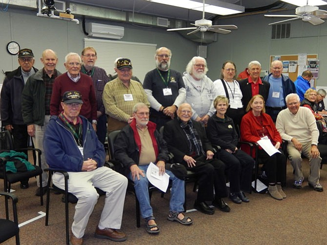 The military veterans attending OLLI's annual ceremony honoring them pose for a group photo.