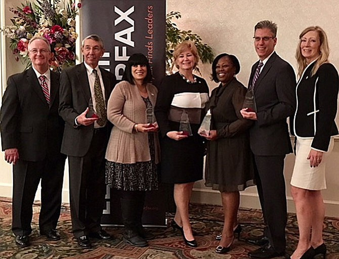 From left: Leadership Fairfax Board Chairman Tim Sargeant, Dominion Energy; Stephen Fuller accepting for Bob Buchanan, president, the 2030 Group, Regional Leadership Award; Rikki Epstein, The Arc of Northern Virginia, Nonprofit Leader Award; Patti Stevens, Executive Director, Fairfax County Office of Public-Private Partnerships, Trustee Leadership Award; Phyllis Pajardo, Superintendent, City of Fairfax Schools, Educational Leadership Award: Mike Coogan, for Leidos, Corporate Leadership Award; and Karen Cleveland, president and CEO, Leadership Fairfax.