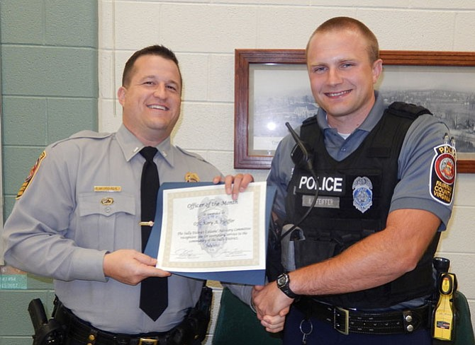 Lt. Ryan Morgan (left) presents the Officer of the Month award to PFC Kory A. Pfeiffer.