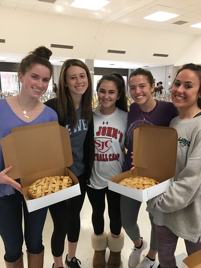 Bullis School seniors Samantha Durham, Jessica Ravitch, Kate Morris, Sophie McIntyre, and Rachel Gordon show off two of the pies students baked Saturday.
