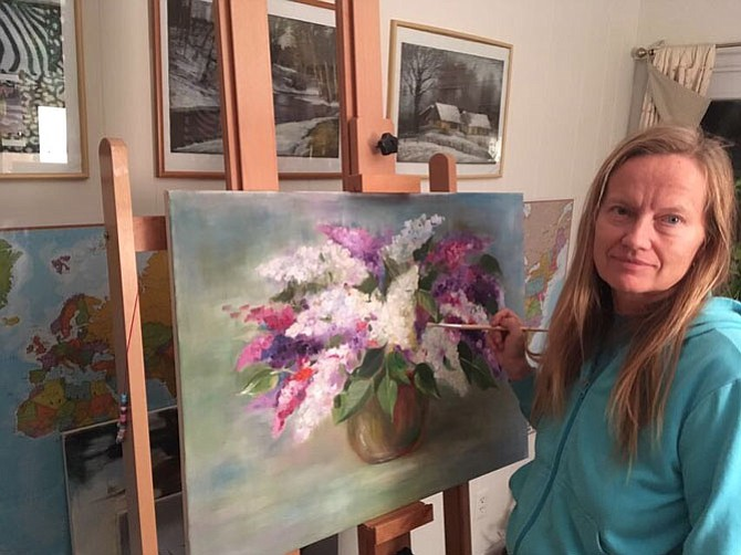 Artist Inese Platere with her work.