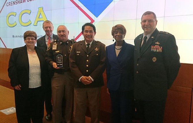 Alexandria Chamber of Commerce chair-elect Gin Kinneman, Chamber CEO Joe Haggerty, Deputy Ernesto Arroyo, Sergeant Waraphan Srikongyos, retired firefighter Callie Terrell and USAF Maj. Gen. Mark K. Johnson at the Salute to Veterans Awards Nov. 8 at Mount Vernon Estate.
