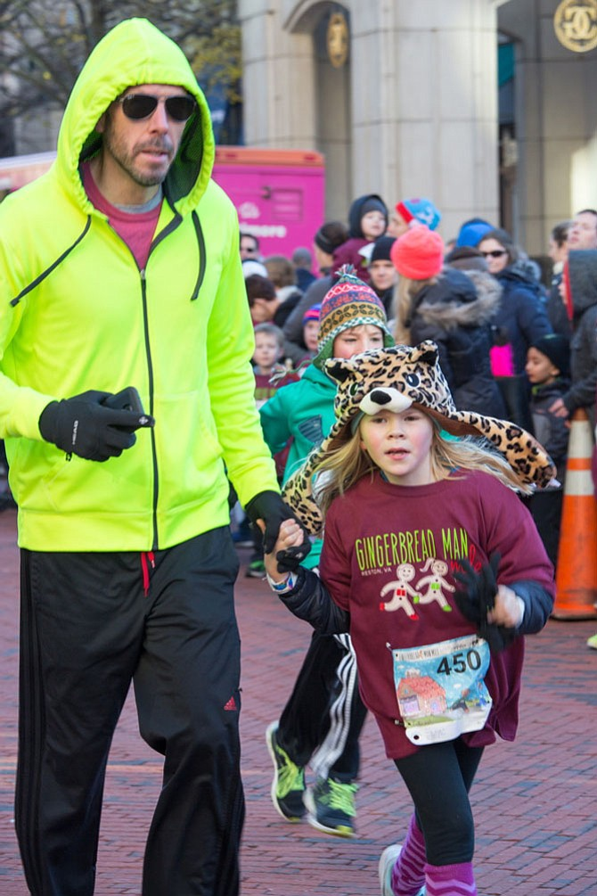 Eric Klinker, of Ashburn, an IT professional, ran the race with his daughter Vivienne, 8, Friday morning at Reston Town Center.