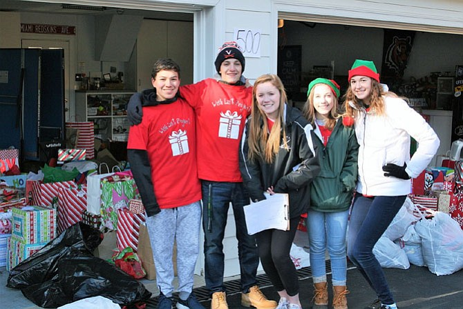 High-school volunteers organize gifts for four shelters.