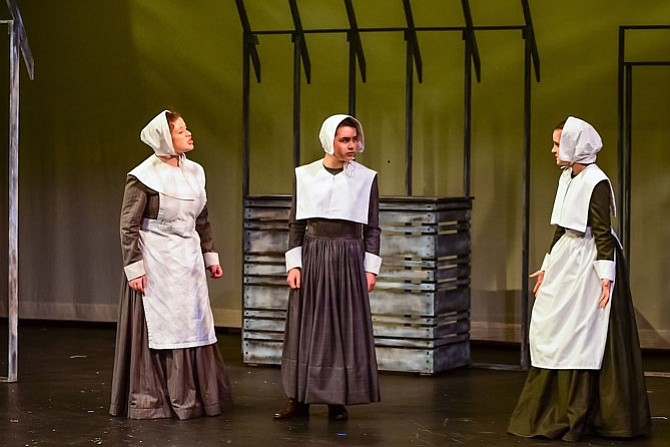 "From left: Maya Jaffe, Julianne Cuevo, Hannah Khan in Flint Hill School's production of ""The Crucible."""