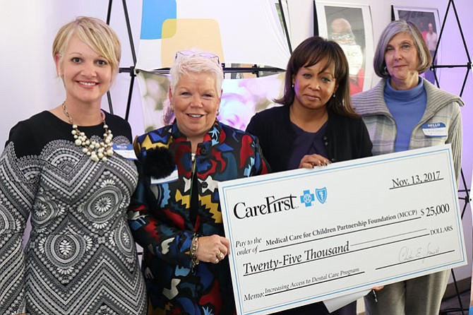 MCCP's check presentation. From left: Penny Bladich, board chair, MCCP; Marcia Twomey, Executive Director, MCCP; Maria Harris Tildon, Senior Vice President of Public Policy and Community Affairs, CareFirst; and, Andrea Lomrantz, Director of Family Services, Fairfax County.