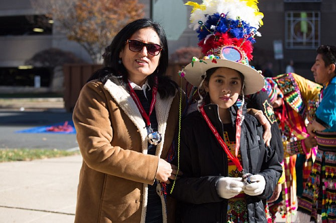 From left: Ayda Lopez and Alejandra Villareal pictured, as members of Bolivian Tinkus San Simon get ready to perform at Reston Town Center's 27th annual Holiday Parade on Friday.
