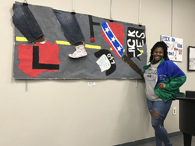 Jordan Roberts, a South Lakes High School 12th grader from Reston, pictured with her Artspeaks piece.