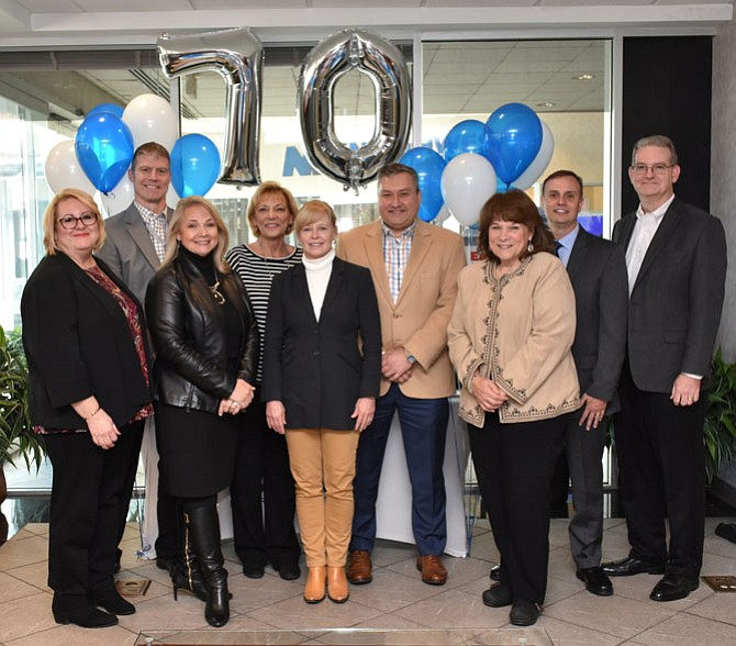 Members of Northwest Federal Credit Union's Board of Directors and Executive Team (from left): Erin Krause, Joe Hasto, Victoria Gillespie, Mary Corrado, Jeanne Tisinger, Jeff Bentley, Phyllis Ziakas, Chuck Molina and Mike Kapfer, gather together at the credit union's 70th Anniversary Celebration held Monday, Nov. 20, in Herndon.