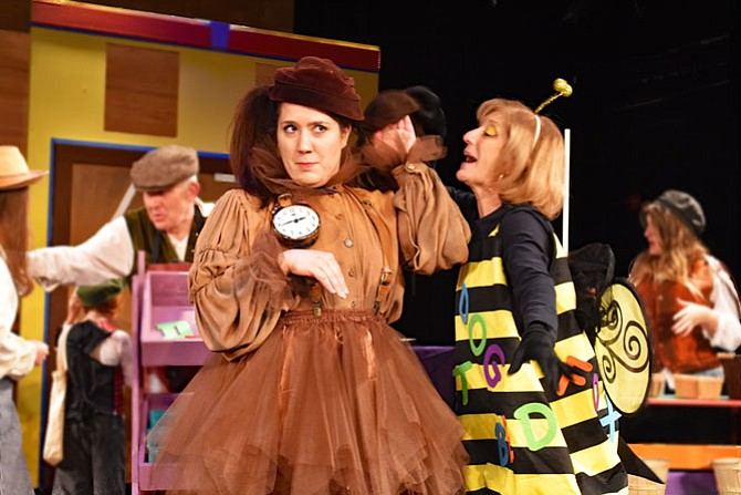 """Amanda Ranowsky as Tock and Susan Kaplan as the Spelling Bee in the Providence Players production of """"The Phantom Tollbooth."""""""