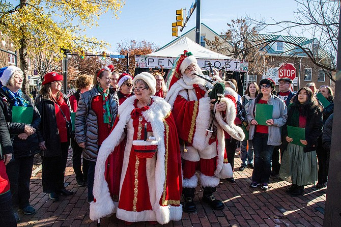 Santa and Ms. Claus with carollers in Old Town for Small Business Saturday.