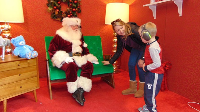 Aiden George of Lorton visits Santa with mom Rachel.