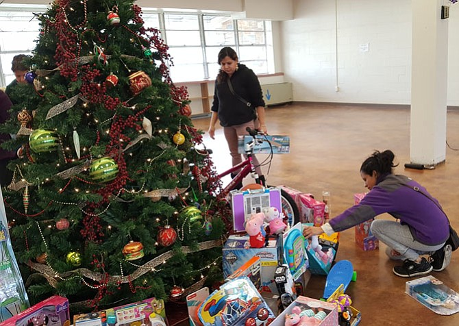 Charitable activities, such as this toy drive by Interfaith Works, can improve one's overall well-being.