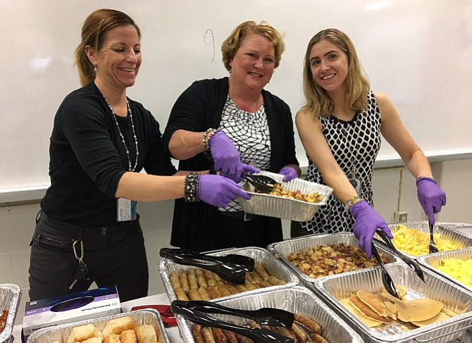 Dishing up hash browns, sausage, pancakes and scrambled eggs are (from left) FCPS career and transition service specialists Sarah Blake, Sue Eaton and Maggie Contreras.