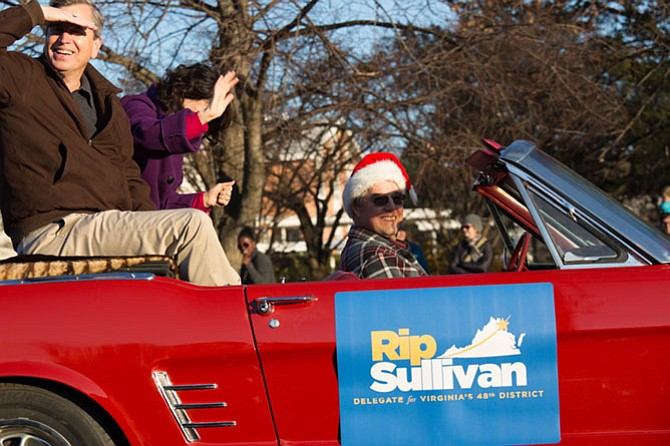 Del. Rip Sullivan (D-48) and his wife Beth Sullivan ride in Bob Coates's Ford Mustang in the ninth annual Winterfest parade in McLean on Sunday, Dec. 3.