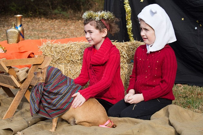John-Pierre, an 8-year-old Chihuahua, in a nativity photo with sisters (left) Victoria Dela Court, third grader at Our Lady of Good Counsel, left, and Gabriella Dela Court, a first grader at Our Lady of Good Counsel outside of The Church of the Good Shepherd Saturday, Dec. 2.