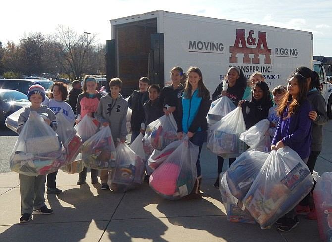 Stone Middle School students prepare to load donated gifts into a truck headed for ONC's warehouse after last year's Panther Drop-Off. This year's collection will be Saturday, Dec. 9, from 9 a.m.-noon.