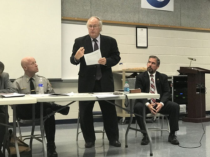 Adrian Steel of McLean explains the workings of the Civilian Review Panel while Police Chief Edwin Roessler and Independent Police Auditor Richard Schott look on at a Mount Vernon meeting in November.