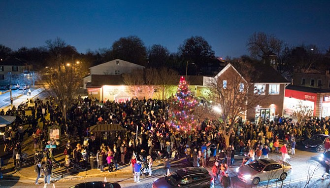 Crowds gather Dec. 2 in the Pat Miller Neighborhood Square for the Del Ray Holiday Tree Lighting ceremony, which featured a 30-foot tree donated by Pork Barrel BBQ's Bill Blackburn and Mike Anderson.