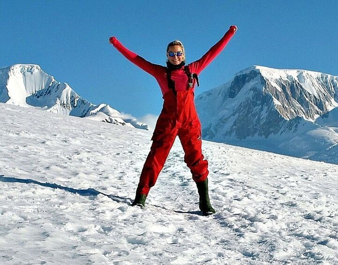 Brooke Curran, shown after completing the Antarctica Marathon in 2015, raises money for children's charities through The RunningBrooke Fund.