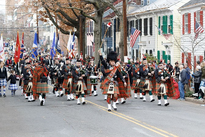 The Saint Andrew's Society Pipes and Drums marches along Queen Street during the 2017 Scottish Walk Parade.