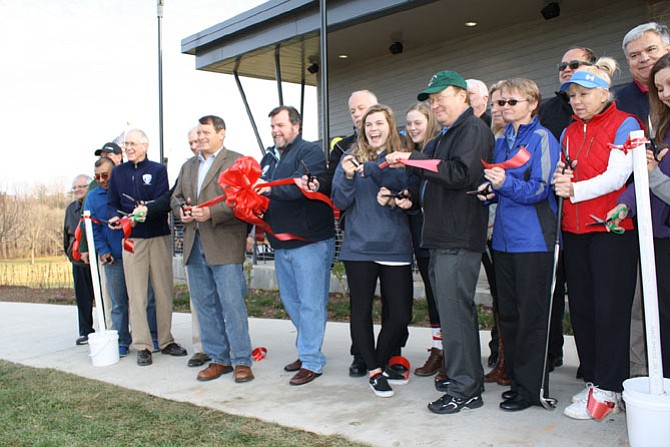 The ribbon is cut for the new clubhouse at Burke Lake Golf Course.