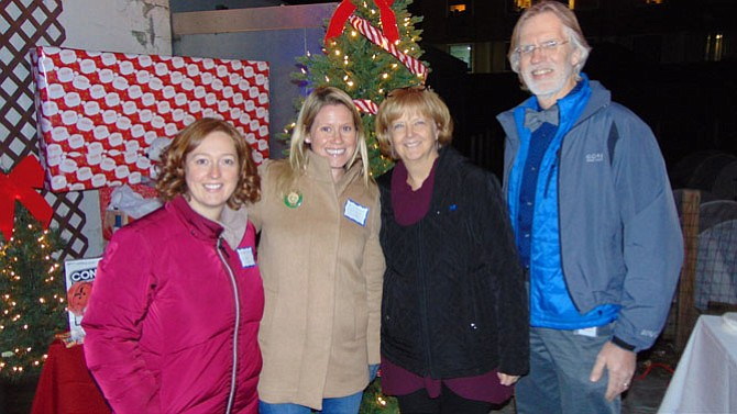 At the Hollin Meadows Elementary School PTA's Happy Hour Toy Drive event on Thursday, Dec. 7 at DRP - Del Ray Pizza are (from left): Elizabeth Richardson, Erin Anderson, School Counselor Deb Storck, and Principal Jon Gates.