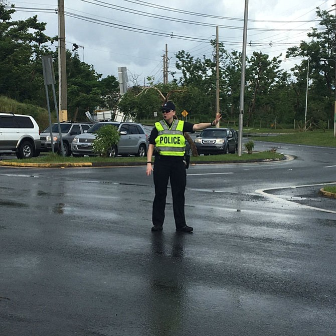 Arlington County Police Department Officer Sarah Butzer directs traffic in Puerto Rico.