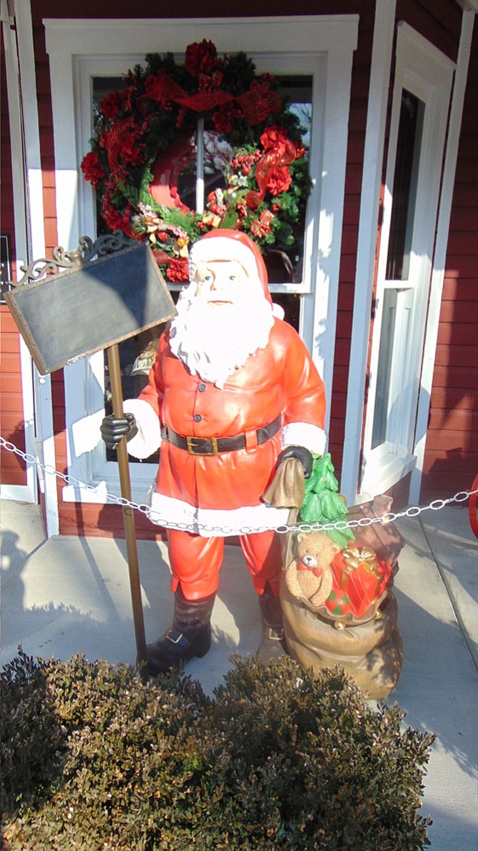 The Santa display in front of Trattoria Villagio in downtown Clifton on Main Street.