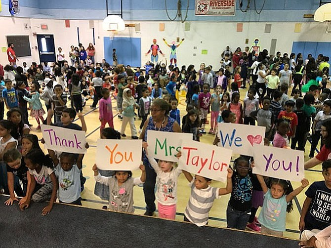 "Riverside Elementary students and staff surprise ""lunch lady"" Dorothy Taylor with a celebration of her 40 years at the school. Full funding of K-12 education is a top priority for the Fairfax County Board of Supervisors."