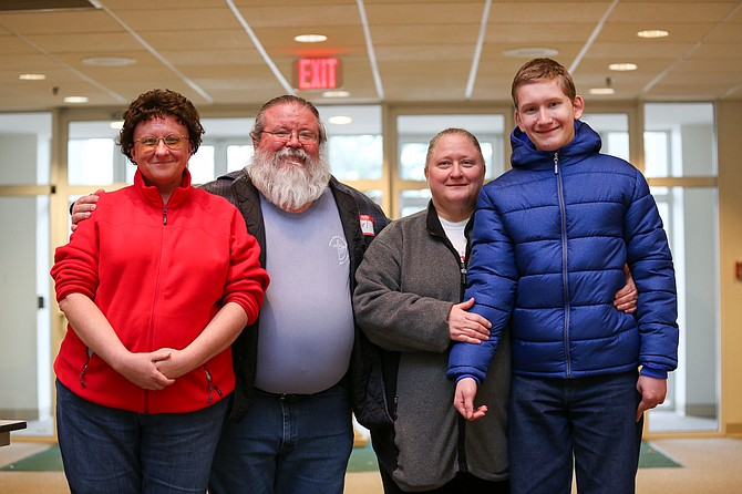 From left: Bridgette Beach; Karl Wilkerson, an officer with CHO and Reston resident; Teresa Creighton, Vienna resident and baker; and her son Sam Creighton, 13, who is homeschooled; pictured at Vienna Committee for Helping Others' Christmas store at Vienna Presbyterian Church Saturday, Dec. 9.