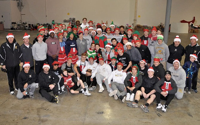Westfield High Varsity Football Coach Kyle Simmons and his newly crowned State Championship team helped ONC move into its warehouse last week in preparation for this year's gift packaging and deliveries.