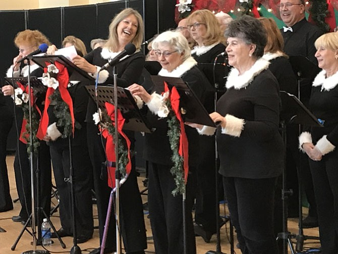 "Members of the Sun Dance Singers directed by ""C"" Culpepper enthusiastically ring in the Christmas season performing a medley of classic holiday favorites during their concert gift to members of local Fairfax County Senior Centers."