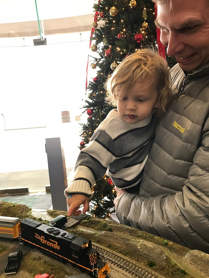 """Two-year-old Simon Baker cannot believe his eyes. The best thing in life has come his way, TRAINS. According to Nathan Baker, Simon's uncle, the toddler's first words when he spoke were """"choo, choo."""""""