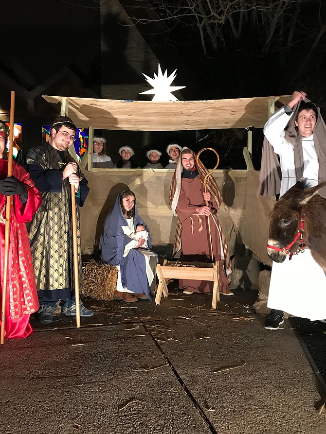 Members of the St. James Episcopal Church Youth Group presented a Living Nativity on the front lawn of the church on Sunday, Dec. 10. The pageant attracted about 100 spectators.