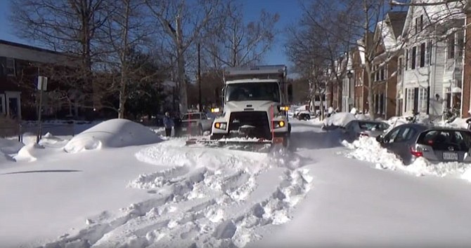 Alexandria City snow plow at work.