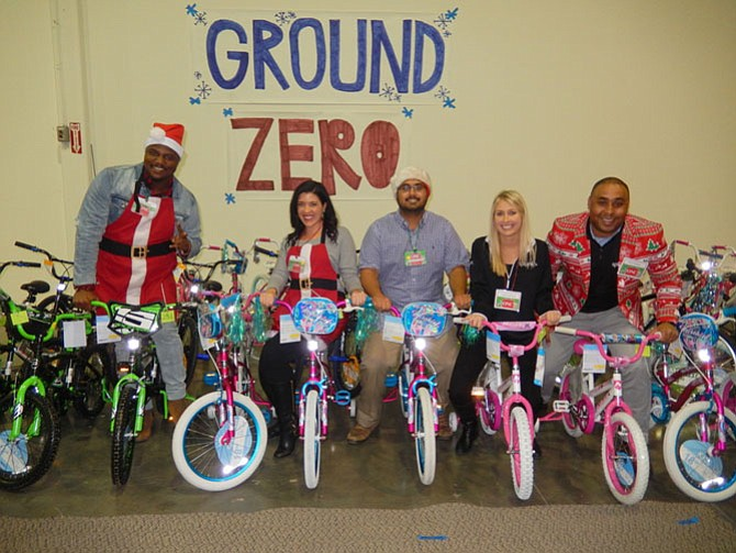Volunteers posing with some of the bicycles to be gifted are (from left) Ralph Harmon and Sarah George, both with Metronome government contractors, and Arjun Suryakant, Kristi Liesegang, and Ron Richmond, all with Splunk software sales.